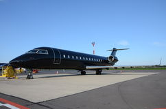 Black private jet. Parked on the apron royalty free stock photography