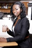 Black profesional woman at the coffeeshop Stock Photos