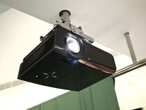 Black projector. A black overhead projector on ceiling indoors royalty free stock image