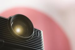 Black projector on a table. Home movie theatre concept background stock image