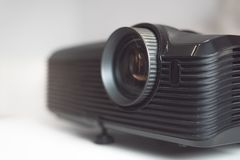 Black projector on a table. Home movie theatre concept background royalty free stock photos