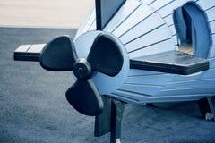 Black propeller on blue plastic toy submarine 2 Stock Photos