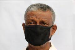 Free Black Protection Mask Wearing Sad Or Worried Senior Indian Man Portrait On White Background. Stock Photo - 185459830