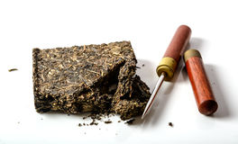 Black pu-erh chinese tea with special knife on a Royalty Free Stock Photography