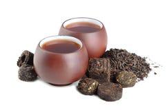 Black pu-erh tea. Various black pu-erh tea on a white background Royalty Free Stock Photos