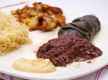 Black pudding with fried potatoes Stock Photography
