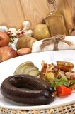 Black pudding with grilled potato Royalty Free Stock Image