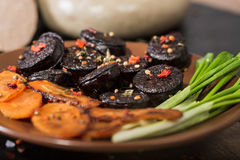 Black pudding sausage  with vegetables Royalty Free Stock Photo
