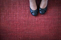 Black Pumps on Red Rug Stock Photos