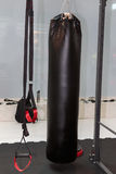 Black Punching Bag and Crossfit Fitness Rings: Workout Equipment Royalty Free Stock Images
