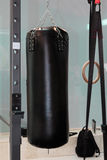 Black Punching Bag and Crossfit Fitness Rings: Workout Equipment Stock Photos
