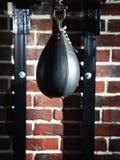 Black punching bag. Royalty Free Stock Photo