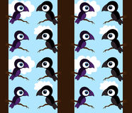 Black and purple crows in a tree background Royalty Free Stock Images