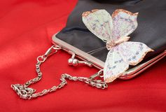 Black purse with butterfly on Valentines Royalty Free Stock Photography