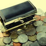 Black purse with coin of different countries Royalty Free Stock Photos