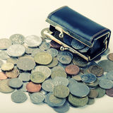 Black purse with coin of different countries Royalty Free Stock Photo