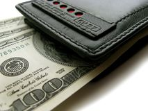 Black purse with dollars. Stock Images
