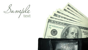 Black purse with dollars Stock Images
