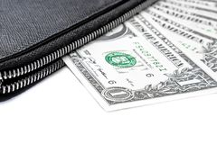 Black purse with dollars Royalty Free Stock Image