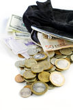 Black purse full of coins Royalty Free Stock Photos