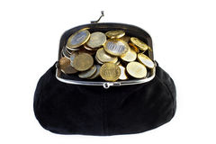 Black purse full of coins Royalty Free Stock Images