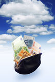Black purse full of money Stock Photos