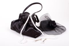 Black purse and hat with jewelry 2 Royalty Free Stock Image