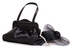 Black purse and hat and pearls Stock Image