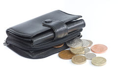 A black purse holding UK coins. A black purse holding UK sterling coins Royalty Free Stock Photos