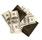 Black purse with lots of dollars Royalty Free Stock Photo