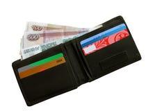 Black purse with money . Royalty Free Stock Photos