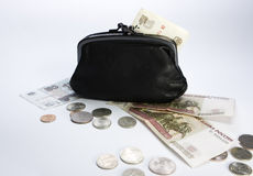 Black purse and money. Black purse fnd money on table Stock Photos