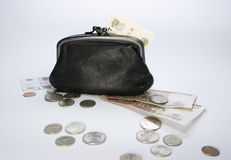 Black purse and money. On table Royalty Free Stock Image