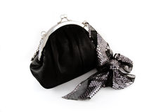 Black purse with ribbon. Black purse with shiny sequin ribbon for special moments Royalty Free Stock Photos