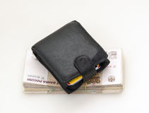 Black purse and ruble money Royalty Free Stock Images