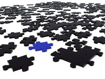 Black puzzle piece amongst black ones Stock Images