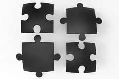 Black puzzle pieces. Four puzzle pieces isolated on a white background. Concept for team and teamwork Royalty Free Stock Photos