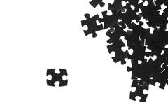 Black puzzle on a white background. Black puzzle laid out on a white background Royalty Free Stock Images