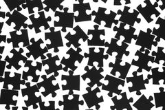 Black puzzle on a white background. Black puzzle laid out on a white background Stock Photo