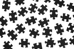 Black puzzle on a white background. Black puzzle laid out on a white background Stock Images