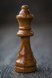 Black Queen, Chess Piece on a Wooden Table Royalty Free Stock Image