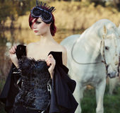 Black queen with huge pure white horse Royalty Free Stock Photo