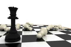 Black queen standing with fallen white pawns Royalty Free Stock Photo