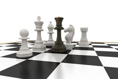 Black queen surrounded by white pieces Stock Photos