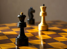 Black queen and white king on the chessboard Royalty Free Stock Photo