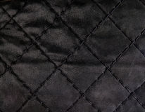 Black quilted leather backgound. Close up Royalty Free Stock Image