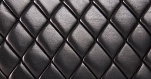 Black quilted leather background. Black quilted  natural leather background Stock Photography