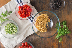 Black quinoa, chickpeas, peppers, cucumber, tomatoes and parsley Royalty Free Stock Photography