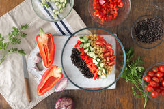 Black quinoa, chickpeas, peppers, cucumber, tomatoes, parsley. S Royalty Free Stock Images