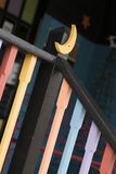 Black Railing with Moon 1. Black Railing with Moon accent. Railings have yellow, orange, blue and purple colors with colorful porch royalty free stock photos